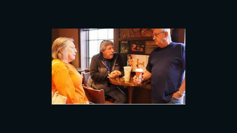 Tim and Shirley Morrison talk with their friend Phil Derosia, left, about the loss of the Morrisons' house in Gatlinburg on Wednesday.