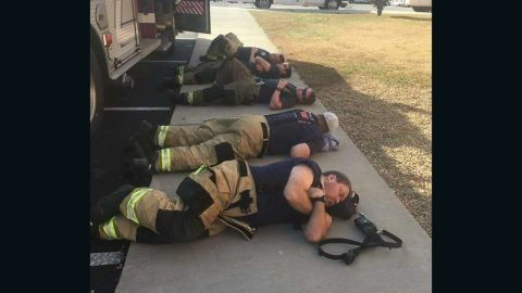 Firefighters from the Johnson City Professional Firefighters Association L-1791 rest after 36 hours of battling the fires around Gatlinburg, TN