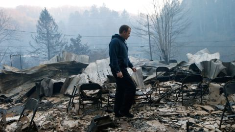 Trevor Cates walks through the smoldering remains of the fellowship hall of his church.(Photo by Brian Blanco/Getty Images)