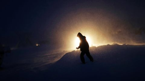 A person walks through snow and wind on Tuesday, November 29.