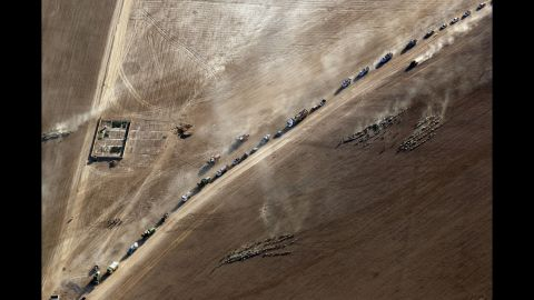 Displaced civilians return to the village of Tall Abtah on Friday, November 25, after Iraqi forces retook the village from ISIS.