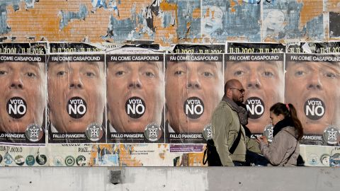 """People walk past poster of far-right political movement CasaPound which call to vote """"No"""" at the constitutional referendum, on November 30, 2016 in Rome. Italy holds a referendum on December 4, 2016 on proposed constitutional reforms that are considered the most important in the eurozone country since World War II.  / AFP / FILIPPO MONTEFORTE        (Photo credit should read FILIPPO MONTEFORTE/AFP/Getty Images)"""