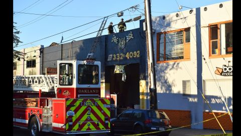 Firefighters assess the scene where a fire tore through a warehouse party early Saturday, December 3, 2016 in Oakland, California. The blaze began at about 11:30 p.m. on Friday during a party at a warehouse in the San Francisco Bay Area city.
