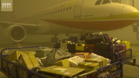 A plane grounded at the Chengdu Shuangliu International Airport in China by thick fog and smog from pollution.