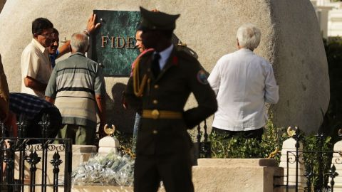 Workers place a plaque with the word 'Fidel' on the tomb holding the remains of former Cuban President Fidel Castro in the Cementerio Santa Ifigenia where he will be buried December 4, 2016 in Santiago de Cuba, Cuba. Sunday marked the last of a nine-day mourning period after Castro died November 25 at the age of 90.