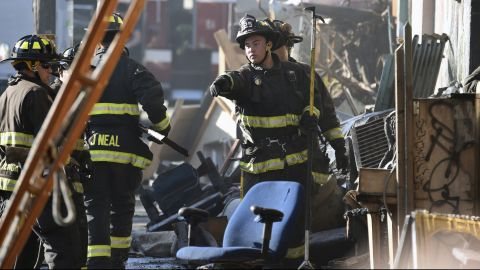 Firefighters assess the scene where a deadly fire tore through a late-night electronic music party in a warehouse in Oakland, California, December 3. Officials described the scene inside the warehouse, which had been illegally converted into artist studios, as a death trap that made it impossible for many party goers to escape the Friday night fire.