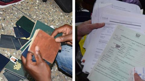 Some of the 150 passports and other identification paperwork seized during the raids.