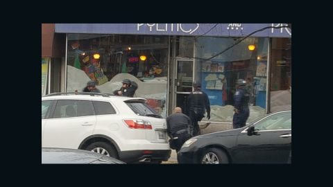 DC police respond to the pizzeria after a man with a gun entered the premesis.