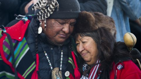 """Activists embrace after the December halt of the <a href=""""http://www.cnn.com/2016/09/07/us/dakota-access-pipeline-visual-guide/"""" target=""""_blank"""">Dakota Access Pipeline</a> route. The $3.7 billion project that would cross four states and change the landscape of the US crude oil supply. The Standing Rock Sioux tribe says the pipeline would affect its drinking-water supply and destroy its sacred sites."""
