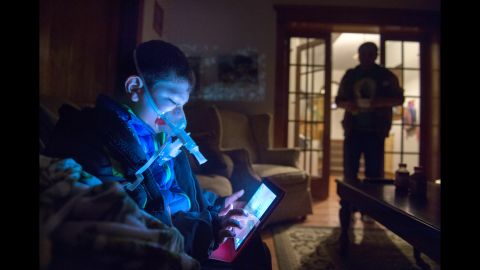 Daniel Iniguez uses a nebulizer every morning to inhale medicine in his home in Ontario, California.