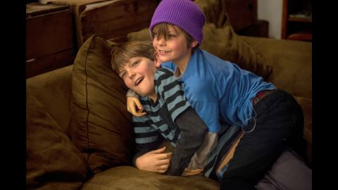 Cohen and Emmett wrestle with each other at home. Older brother Cohen, 10, is capable of monitoring his own glucose levels and counting his own carbohydrates, but he sometimes forgets. Both boys have emergency diabetes kits in their classrooms at school.