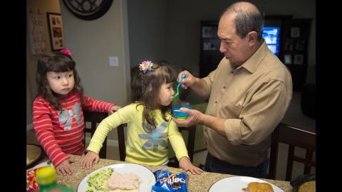 """The twins' grandfather, Daniel, plays a critical role in the girls' care. Daniel comes to the Madrigal house in Marysville, California, every morning between 5 and 6 a.m. to get his grandchildren ready for school, drop them off at school, and take the twins to their appointments. """"Grandpa has been an angel sent from heaven to help us with the twins,"""" says their mom, Criss."""