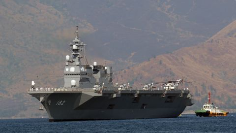 Japanese helicopter carrier Ise is towed as it prepares to dock at the former US naval base, Subic port, north of Manila on April 26, 2016.  Ise (DDH 182), which is in the Philippines for a four-day goodwill visit, marking a third time Japanese vessels have visited the country in a year, with two Japanese destroyers and a submarine docked April 3 near disputed South China Sea waters, where Beijing's increasingly assertive behaviour has sparked global concern. / AFP / TED ALJIBE        (Photo credit should read TED ALJIBE/AFP/Getty Images)