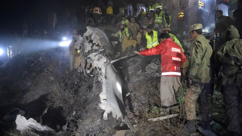 Pakistani soldiers and volunteers search for victims from the wreckage of the crashed PIA passenger plane Flight PK661 at the site in the village of Saddha Batolni in the Abbottabad district of Khyber Pakhtunkhwa province on December 7, 2016. A Pakistani plane carrying 48 people crashed on December 7, in the country's mountainous north and burst into flames killing everyone on board, authorities said, in one of the deadliest aviation accidents in the country's history. Pakistan International Airlines Flight PK661 came down while travelling from the city of Chitral to Islamabad, the civil aviation authority said. / AFP / AAMIR QURESHI        (Photo credit should read AAMIR QURESHI/AFP/Getty Images)