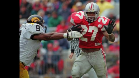 """Ohio State's Eddie George pulls away from Iowa defender Bill Ennis-Inge in Columbus, Ohio, on October 28, 1995. After retiring from the NFL, George took up acting and appeared on Broadway as lawyer Billy Flynn in the musical """"Chicago"""" <a href=""""http://www.nytimes.com/2016/01/19/theater/eddie-george-leaps-to-chicago-from-the-nfl.html?_r=0"""" target=""""_blank"""" target=""""_blank"""">this year</a>."""