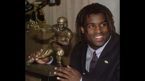 Texas tailback Ricky Williams poses with the Heisman Trophy at the Downtown Athletic Club in New York on December 12, 1998.