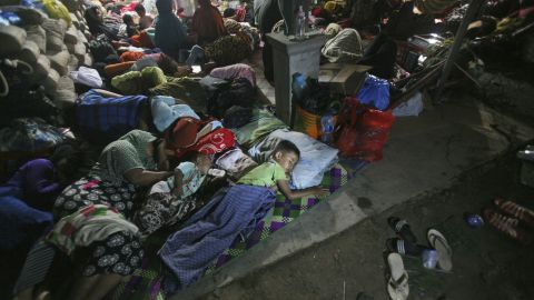 Quake survivors take refuge at a temporary shelter in Ulim, Aceh province, on December 8.