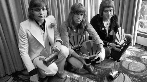 """<a href=""""http://www.cnn.com/2016/12/09/entertainment/greg-lake-dies-trnd/index.html"""" target=""""_blank"""">Greg Lake</a>, a founding member of influential progressive rock group Emerson, Lake & Palmer, died December 7 after a bout with cancer, his manager said. He's seen here at left with bandmates Keith Emerson, center, and Carl Palmer in 1972."""