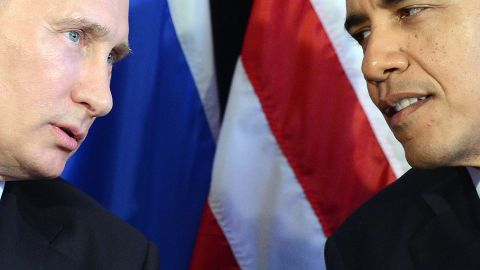 """US President Barack Obama (R) listens to Russian President Vladimir Putin after their bilateral meeting in Los Cabos, Mexico on June 18, 2012 on the sidelines of the G20 summit. Obama and President Vladimir Putin met Monday, for the first time since the Russian leader's return to the presidency, for talks overshadowed by a row over Syria. The closely watched meeting opened half-an-hour late on the sidelines of the G20 summit of developed and developing nations, as the US leader sought to preserve his """"reset"""" of ties with Moscow despite building disagreements. AFP PHOTO/Jewel Samad        (Photo credit should read JEWEL SAMAD/AFP/Getty Images)"""