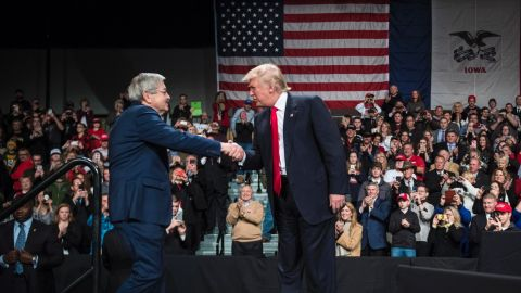 """Trump shakes hands with Iowa Gov. Terry Branstad at an event in Des Moines, Iowa, on Thursday, December 8. Trump <a href=""""http://www.cnn.com/2016/12/07/politics/terry-branstad-ambassador-china/"""" target=""""_blank"""">re-introduced Branstad</a> as his pick for US ambassador to China."""