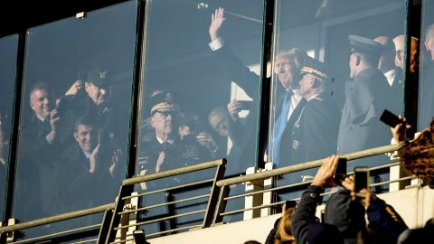Trump waves during the Army-Navy football game, which was played in Baltimore on Saturday, December 10.