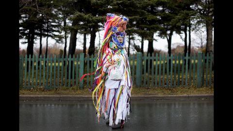 "Marcia Lawson wears ""ribbon fool"" attire. A ribbon fool is a prankster in traditional mummering."