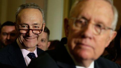 Sen. Chuck Schumer smiles as Senate Minority Leader Harry Reid talks to the media on Capitol Hill on September 27, 2016.