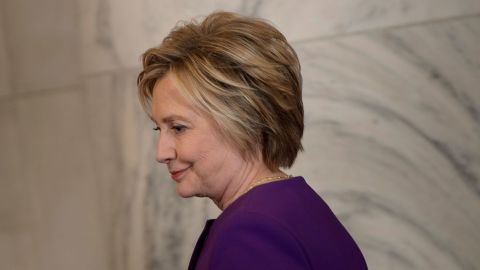 Hillary Clinton arrives for a portrait unveiling for outgoing Senate Minority Leader Senator Harry Reid on Capitol Hill on December 8, 2016.