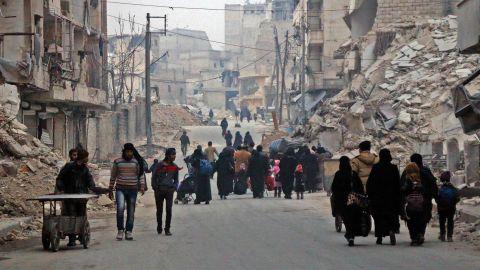 Civilians flee the Sukkari neighborhood in southeastern Aleppo on December 12.