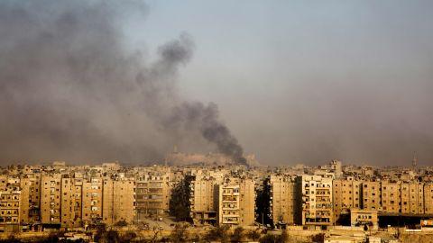 Smoke rises from the Bustan al-Qasr neighborhood on December 12.
