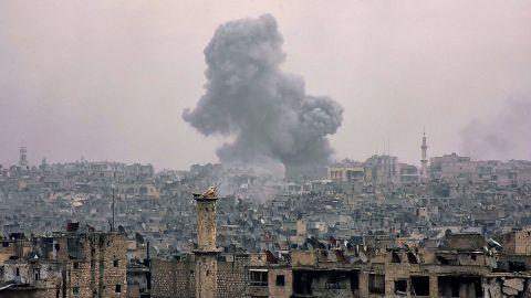 Clouds of smoke billow from eastern Aleppo's al-Shaar neighborhood on Monday, December 5.