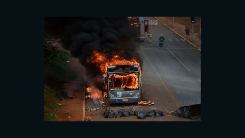 Students set buses on fire during a protest in front of the National Congress in Brasilia on December 13, 2016.