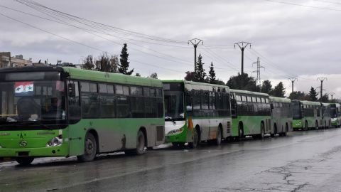 Buses wait to evacuate people in Aleppo on December 14.