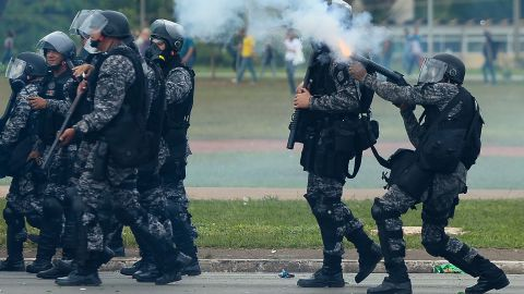 Riot police fire tear gas grenades at protesters in Brasilia on December 13.