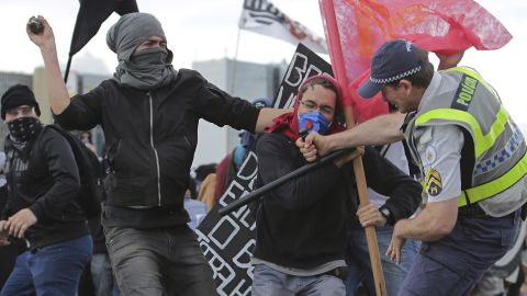 A fight breaks out between demonstrators and police in Brasilia on December 13.