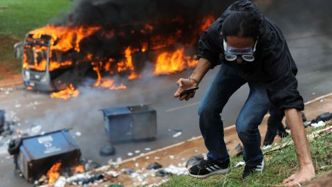 A bus blazes after being set on fire by protesters in Brasilia.
