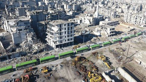 Buses line up to transport people away from eastern Aleppo on December 15.