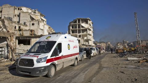 Wounded Syrians and their families gather at the rebel-held al-Amiriyah neighbourhood as they wait to be evacuated to the government-controlled area of Ramoussa on the southern outskirts of the city on December 15, 2016.  Russia, Syrian military sources and rebel officials confirmed that a new agreement had been reached after a first evacuation plan collapsed the day before amid fresh fighting. Syrian state television reported that some 4,000 rebels and their families were to be evacuated.    / AFP / KARAM AL-MASRI        (Photo credit should read KARAM AL-MASRI/AFP/Getty Images)