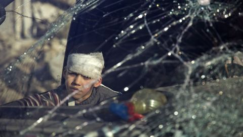A wounded boy sits inside an ambulance during the evacuations on December 15.