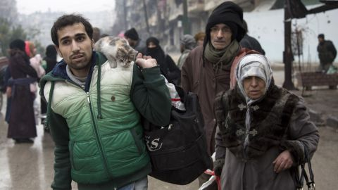Syrians depart a rebel-controlled area of Aleppo on December 13.