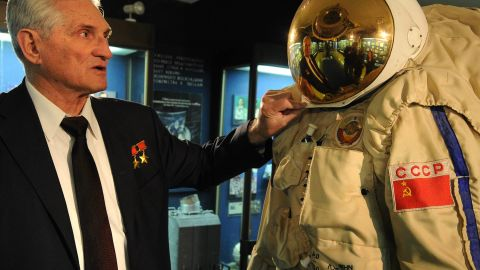 Former Soviet cosmonaut Boris Volynov, a contemporary of Yuri Gagarin, the first human in space, inspects a space suit at Moscow's Museum of Cosmonautics.
