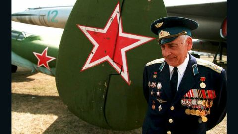Veteran Vladimir Yermakov stands next to a TU-2 bomber, an airplane he flew during World War II and which is now on display at the Monino Aviation Museum near Moscow.
