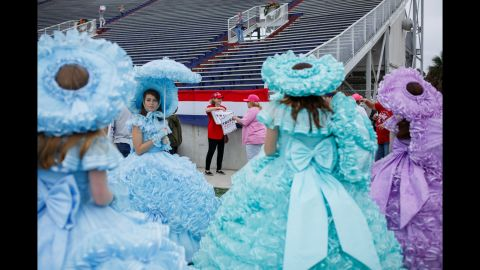Mobile's Azalea Trail Maids welcome attendees. They are a group of high school seniors who serve as city ambassadors.