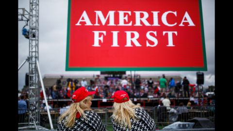 """Identical twins Brenda Simmons, left, and Linda Bookout of Robertsdale, Alabama, attend the rally. """"This is our President,"""" Bookout said. """"We are excited."""""""