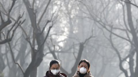 Women walk through Beijing's Ritan Park on December 19.