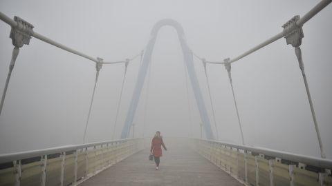 A pedestrian walks on an overpass in Tianjin, China, on December 19.