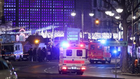 An ambulance and rescue workers arrive to the area after a lorry truck ploughed through a Christmas market on December 19, 2016 in Berlin, Germany. Several people have died while dozens have been injured as police investigate the attack at a market outside the Kaiser Wilhelm Memorial Church on the Kurfuerstendamm and whether it is linked to a terrorist plot.