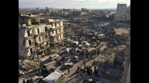 Civilians wait to be bussed out of besieged areas of eastern Aleppo, Syria, as evacuations continue on Monday, December 19. A people-swap deal struck between rebels and Syrian government forces was set to begin over the weekend, but evacuations were temporarily put on hold after a number of buses were set on fire.