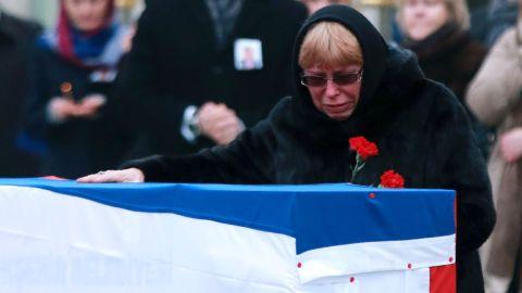 Marina Davydova Karlova bids farewell Tuesday to her husband, the late Russian envoy, in Ankara.