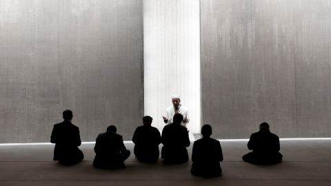 """The form of this poetic building is focused, the architects say, """"solely on the essence of religious space."""" Even the mihrab seems missing, its place taken by a beam of light shining through a fissure in a bare concrete wall."""